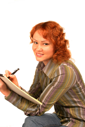 young woman writing on notebook