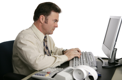 An Accountant Using An Online Program To Do Income Taxes