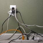 Hiding the Tangle of Cords On Your Desk: 3 Containment Strategies