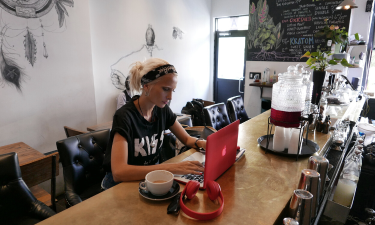 woman entrepreneur working in a cafe