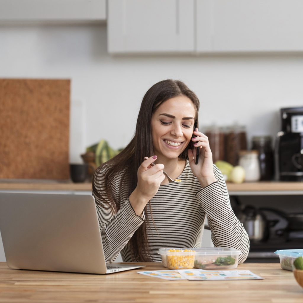woman entrepreneur working from home and eating