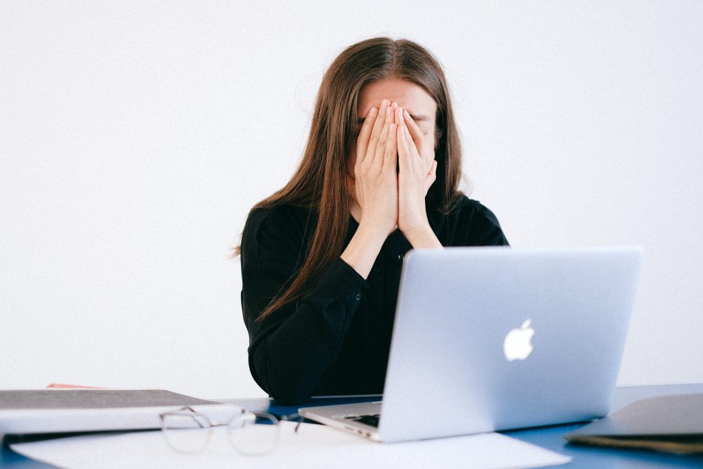 stressed woman entrepreneur on her computer