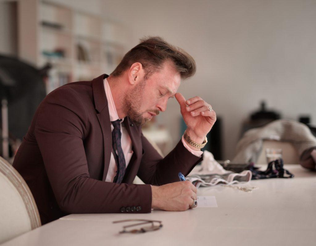 worried entrepreneur writing on paper